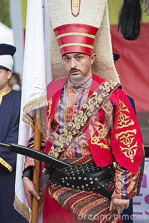 BUCHAREST, ROMANIA - MAY 17: Unidentified member of military fanfare Mehter poses in traditional Janissary costume during the celebratory events Turkish Festival on May 17, 2013 in Bucharest, Romania.