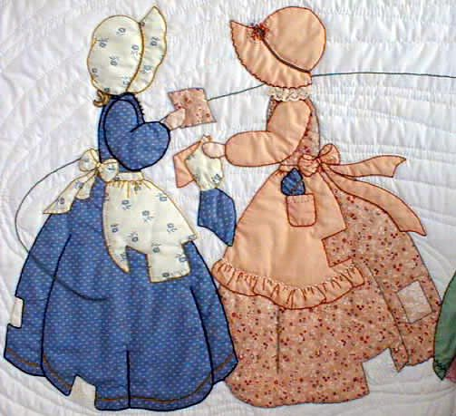 """Bonnet Girls by Helen R Scott. The """"Friendly Quilters """" quilt/wall hanging was a semifinalist in a content sponsored by a national quilt magazine. Although no pattern is available for the patchwork design, all girls and variations on the MEG pattern are included. 1 of 6"""