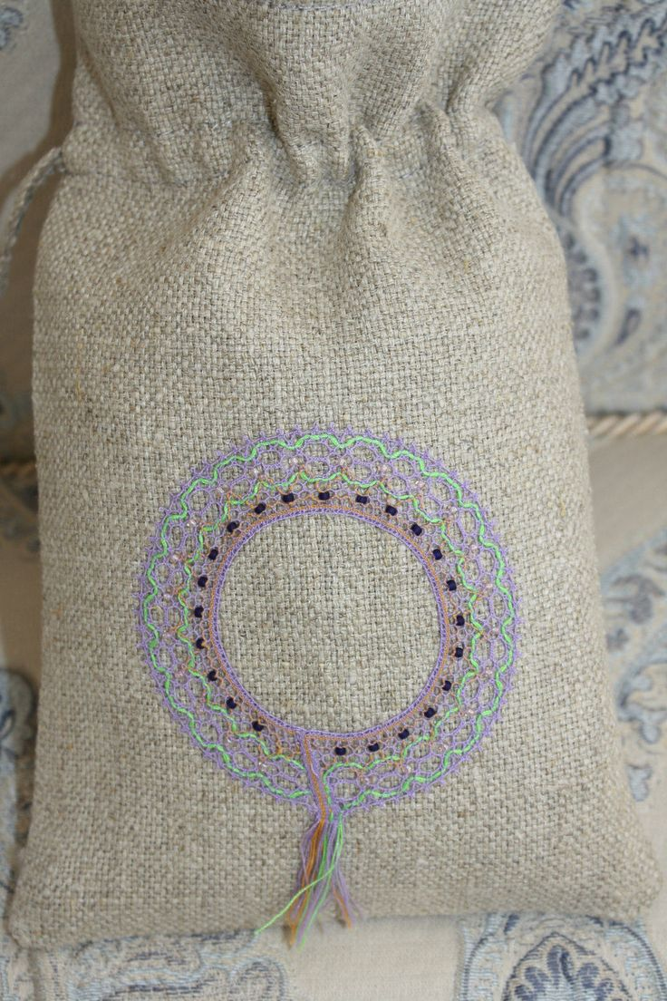 a linen pouch for gifts with handmade bobbin lace by luxurybobbinlace on Etsy