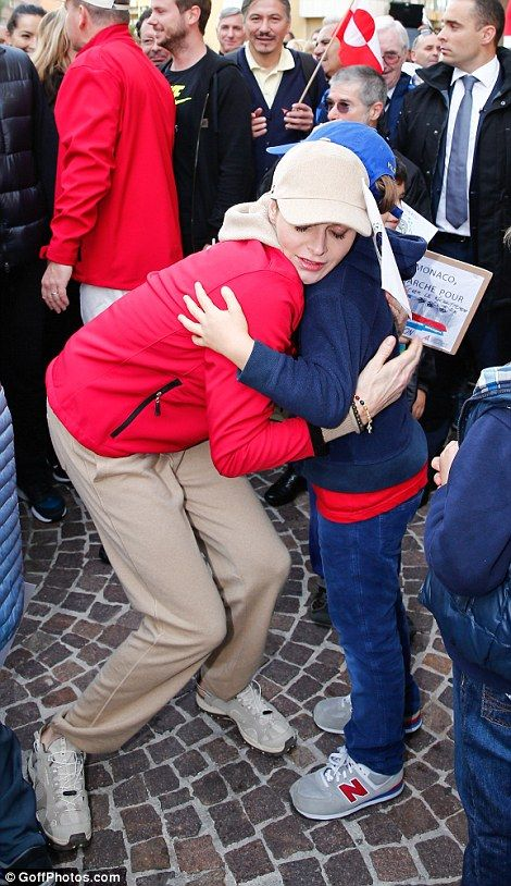 Princess Charlene of Monaco stops to embrace young campaigners during the 'Walk for the cl...