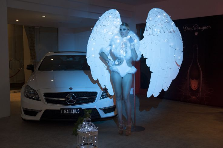 An angel greeted guests from the footpath on their way up to the event on the pool deck in a costume designed by Adam Williams