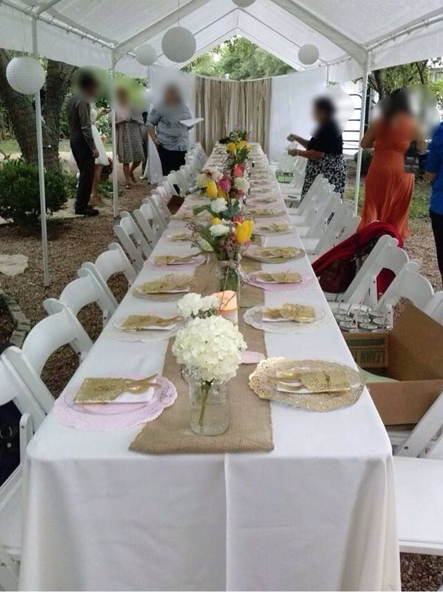 Place settings made by brides sister. Each guest had a mason jar in front of there plate with name on it. We placed a hole on the mason jar lid for a straw.