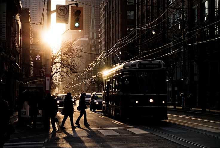 Sun and the Streetcar.  King Street East, at Sherbourne.   Toronto,Canada.