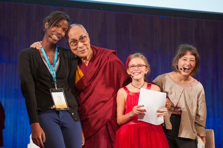 His Holiness the Dalai Lama with the young panelists at the end of a conversation that was part of the SPARK 2014 program organized by the Dalai Lama Center for Ethics and Transformative Values at MIT's Kresge Auditorium in Cambridge, MA, USA on October 31, 2014. (Photo by Brian Lima)