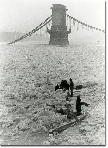 Frozen over Danube, destroyed chain bridge. 1945.