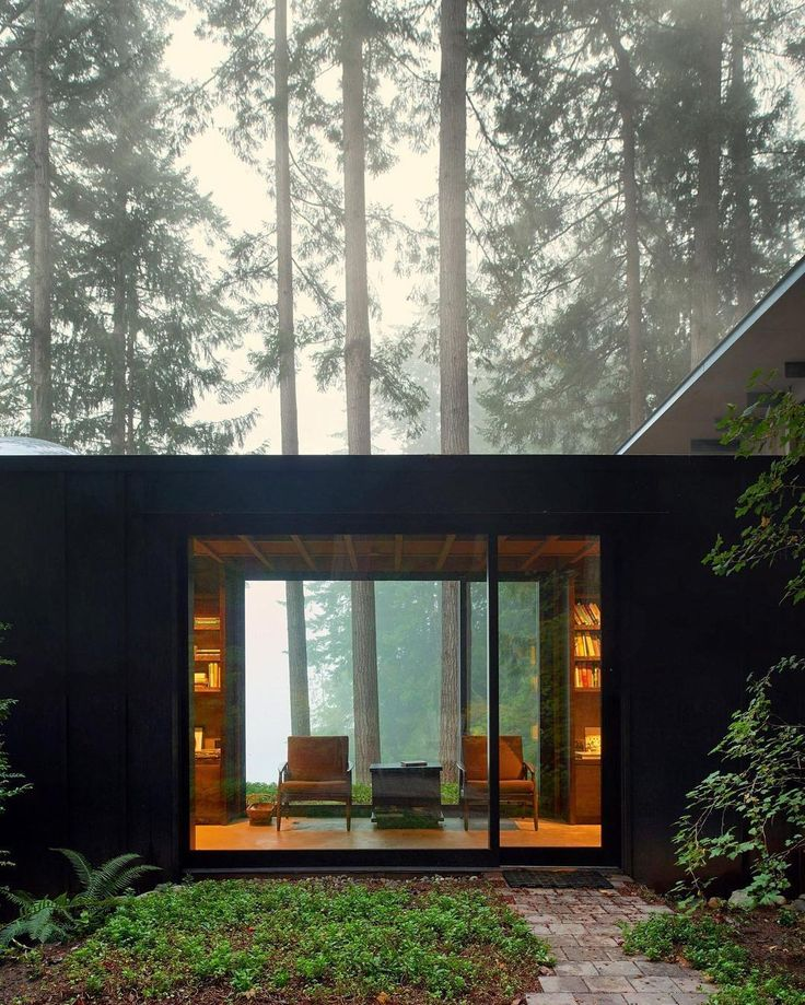 jim olson's admiration for nature is expressed in the design of 'cabin at longbranch' nestled amidst the towering fir trees of an ancient forest in #washington. the living room's large window frames views of the meadow and visually blends indoors and out. photo by kevin scott ⠀ ⠀ ⠀ see more #architecture by @olsonkundig on #designboom #olsonkundig