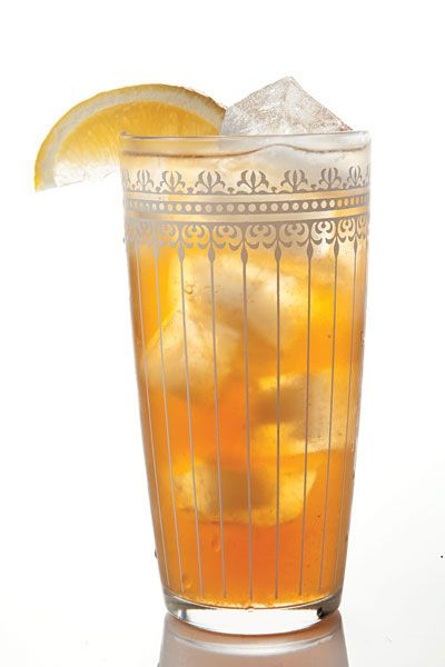 """Long Island Iced Tea Recipe -  Invented in 1972 by Robert """"Rosebud"""" Butt, then bartender at the Oak Beach Inn in Suffolk County, Long Island, this multiliquor drink's reputation for potency quickly made it a classic. -Saveur.com"""