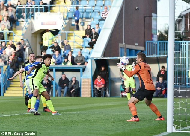 Shaun Miller of Carlisle United scores the equaliser to make it 3-3 against Exeter City
