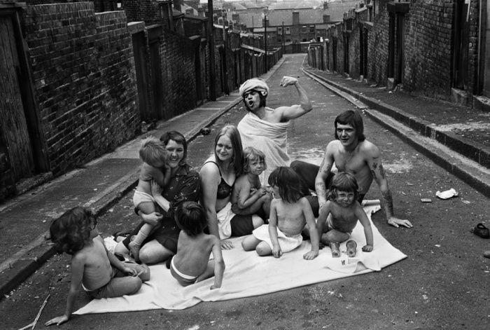 Two families sunbathing in Carville Road/Mason Street back lane, Byker, 1975. Photograph: Sirkka-Liisa Konttinen