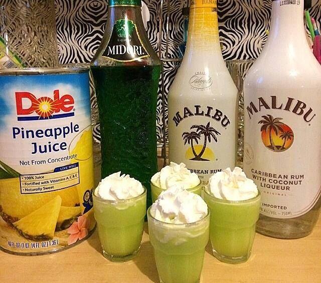 The Scooby Snack ~ 1/2 oz. (15ml) Midori Melon Liqueur, 1/2 oz. (15ml) Coconut Rum, Splash of Pineapple Juice, Splash of Whipped Cream