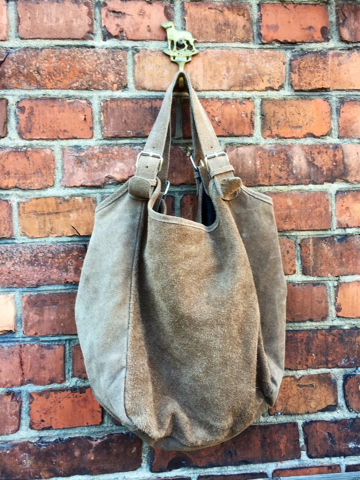 A personal favorite from my Etsy shop https://www.etsy.com/ca/listing/537011218/italian-leathersuedebucket-shoulder-bag