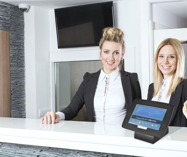 Black matte tablet/ ipad/ android display for reception. http://www.slimlinewarehouse.com.au/desktop-ipad-stand/ipad4cbblk.aspx