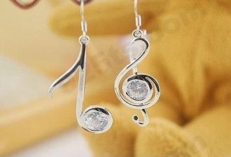 Silver music note earrings with white gems Material: Silver Plated Zinc Alloy Color: Silver, white gem Weight: Light Size: Entire earring (including hook) approx. 2 inches