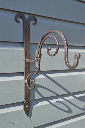 Beautiful Handmade wrought iron curled top by mjknobsandknockers