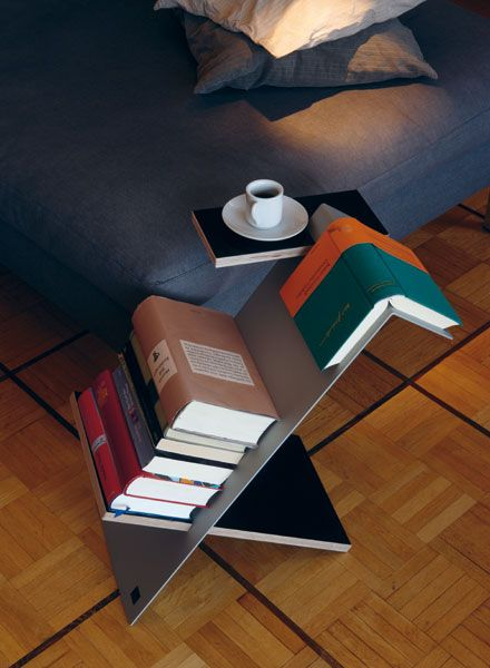 A book shelf, book mark, and coffee table!