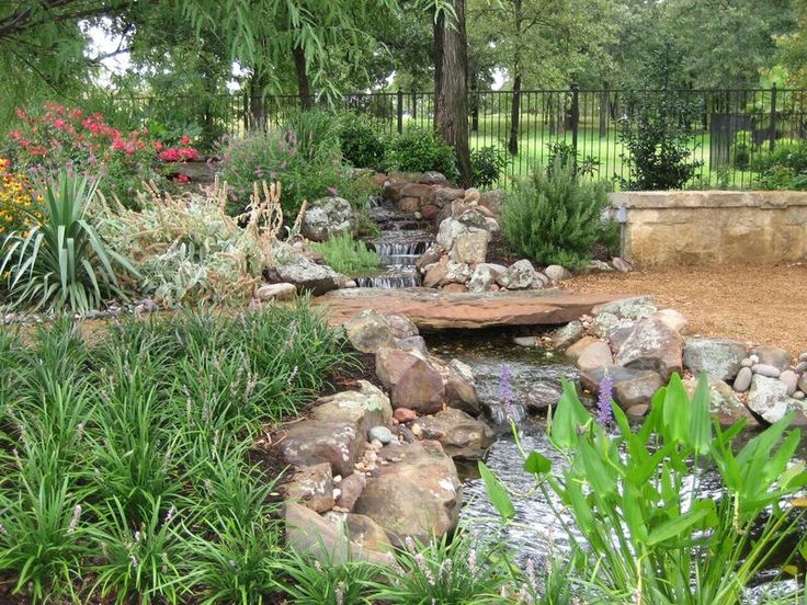 Natural setting for a peaceful stream. By Outdoor Signature in Argyle, TX