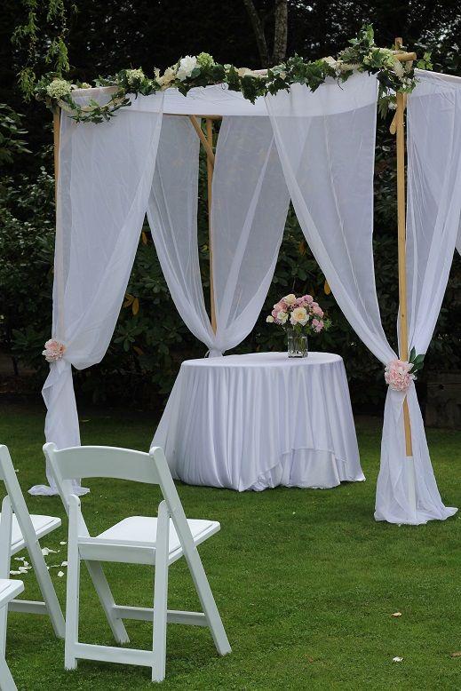 Rectangular/draped archway www.wanakaweddingflowers.co.nz/gallery.php