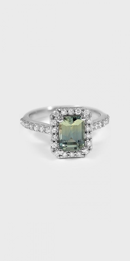 An intricate halo of diamonds embraces and accentuates the center fancy shaped gem of this brilliant antique style ring. Diamond accents on the band add a truly dazzling effect.