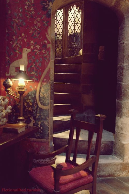 I have no idea where this is, but it's wonderful. [apparently Gryffindor Common Room from the Harry Potter movies] Wall hangings of one of the Lady  the Unicorn tapestries.