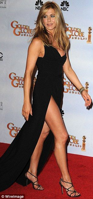 Jennifer Aniston did the long black dress with long slit SOOO much better ~ AND has a much better looking right leg!  :) ~ Golden Globes * January 2010