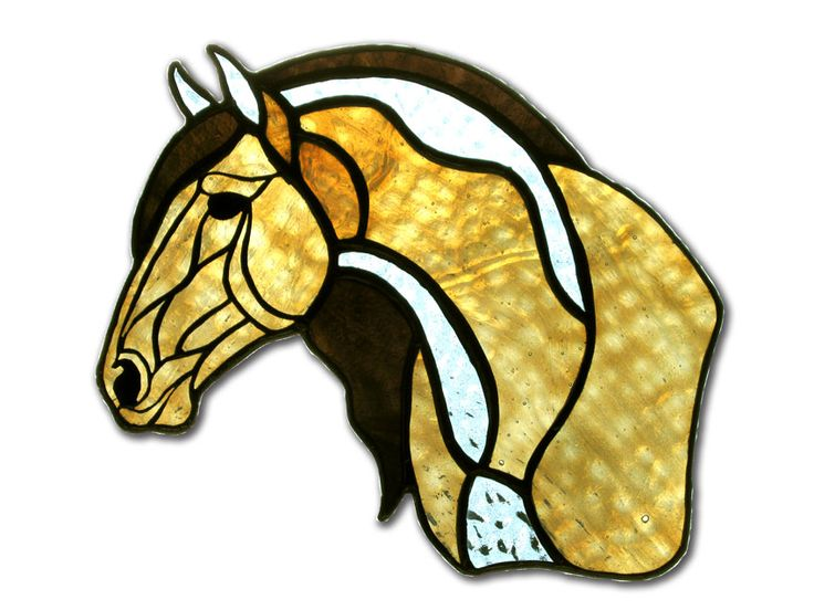 This unusual coloring is created by light directly coming through the back of the stained glass horse and was created by EquineArtglass.com
