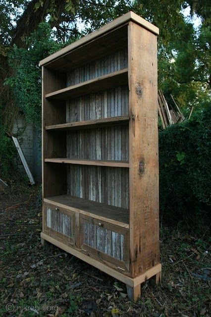 Galvanized tin on the back of the bookcase, and in the doors.....do