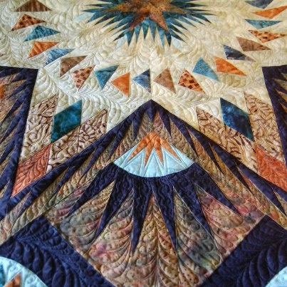 Glacier Star by Susan Mankus closeup of quilting by Carol Jones Morrisseyuploaded by user