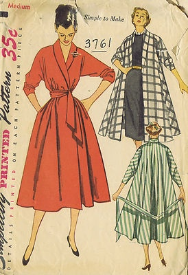 Vintage 50s Coat Dress Coat and Robe Pattern    This versatile style is cut in four sections.  The shawl collar which may be turned up or down in the back is cut in one with the front.  The push-up sleeves are cut in one with back and front.  The self fabric belt can be wrapped around the waistline twice and tied.