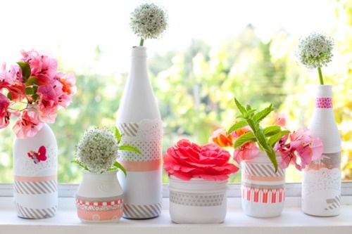 Decorating some white spray painted jars with japanese washi tape and scrap paper is simple and pretty. They look great filled with single sprigs from the garden. Love little jars and bottles like these running down the center of a dining table via A Creative Mint