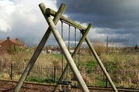 How to Set Wooden Poles for an Adult Swing | eHow