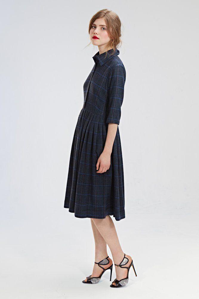 "Mrs Pomeranz ""Beatrice"" dress is made of beautiful Italian woolen tartan fabric. The dress features a shirtwaist bodice with pointed collar, three..."