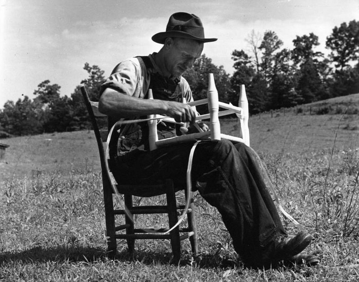 Fred McCarter was an early settler in the Great Smokies and lived until his death in the Glades section of what is now part of the Great Smoky Mountains National Park. Fred is pictured here bottoming a stool with white oak splits he will sell to help sustain his income.