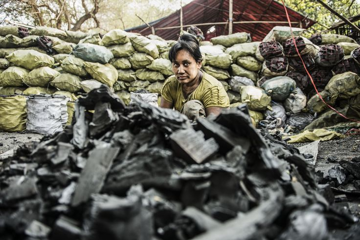 This lady along with her whole family was working in a place where they cut big pieces of charcoal into small ones and then pack them into sacks. (1/3 photos).  Charcoal workers – #Mandalay, #Myanmar