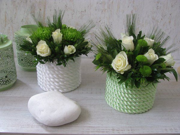 white green arrangements in pots with rope