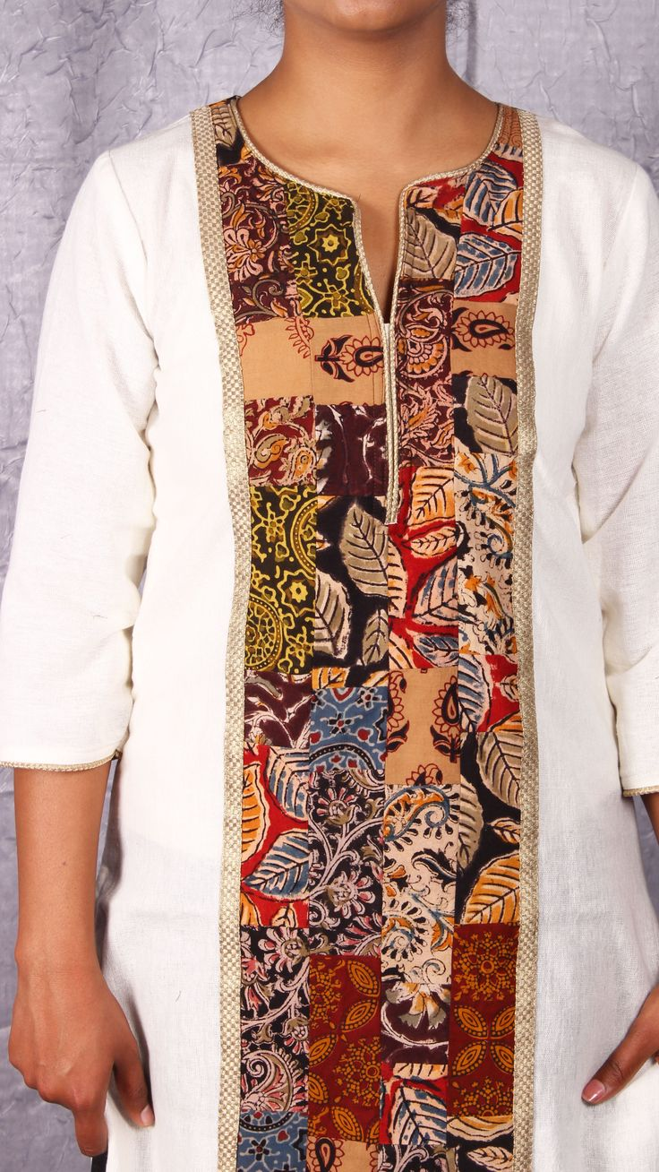 White kurta with kalamkari patch work yoke from www.thesaffronsaga