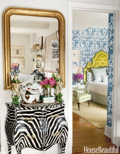 This designer transformed her one-bedroom apartment on the Upper East Side into a vibrant retreat. She found the gilded Louis XVI mirror at a Paris flea market, and the zebra Louis XV–style bombé chest was discovered on 1stdibs. Click through for more colorful decorating inspiration from Lindsey Coral Harper's New York apartment.