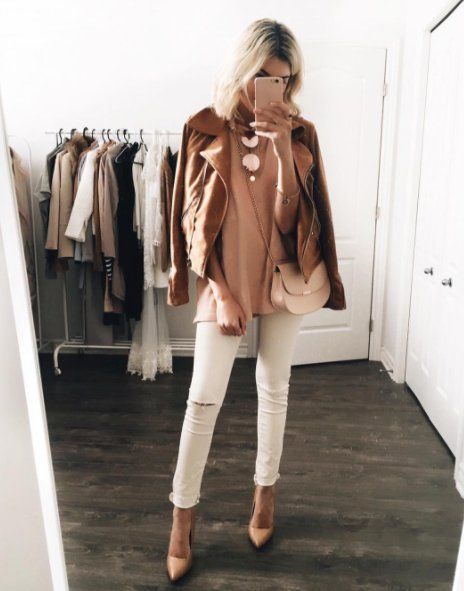 A suede leather jacket with a blush tee, white jeans, and nude pumps.