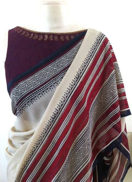 High neck sleeve less blouse on a cotton saree