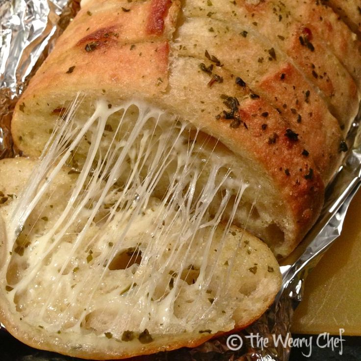 Irresistible Cheesy Pesto Bread. This cheesy garlic bread recipe is easy to make and will impress your friends and family!