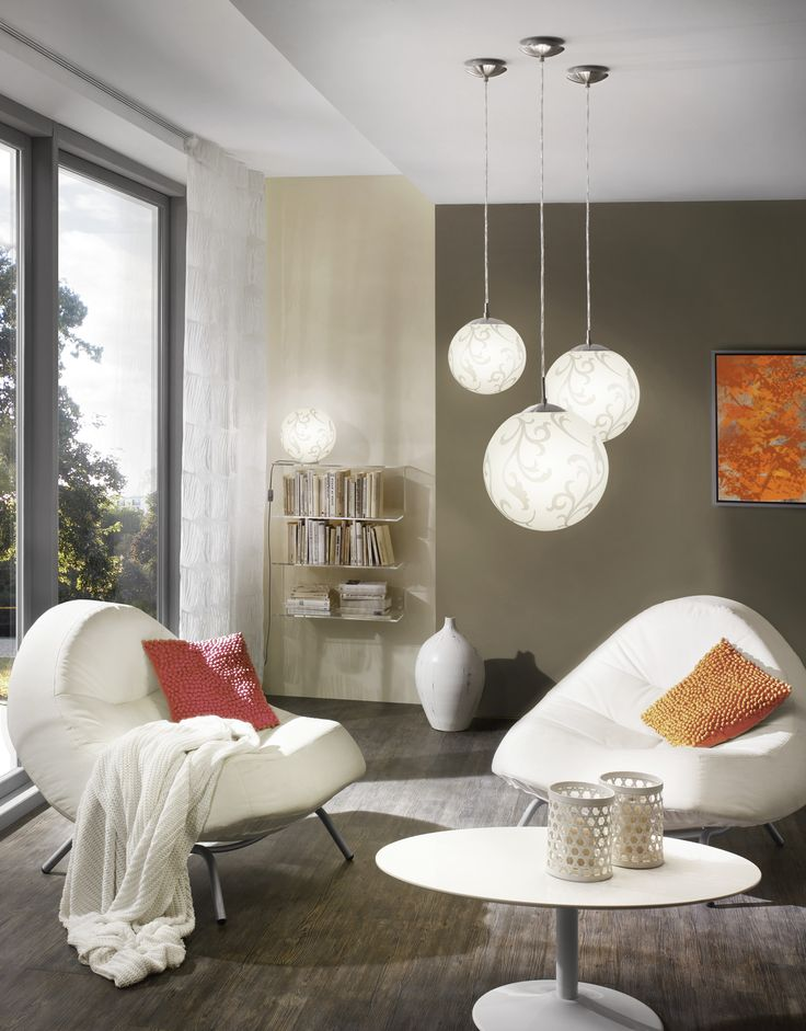 a modern living room made more fun and unique thanks to the eglo rondo pendant and lamp collection