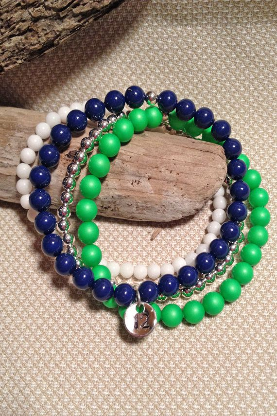 Hey, I found this really awesome Etsy listing at https://www.etsy.com/listing/206829021/seahawks-stretch-charm-bracelet