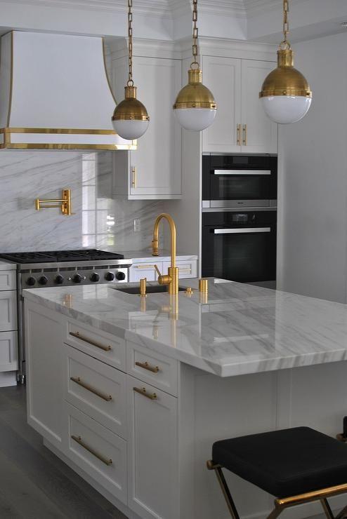 White Kitchen with Gold Accents, Contemporary, Kitchen range hood brass hicks pendants pot filler faucet marble slab backsplash