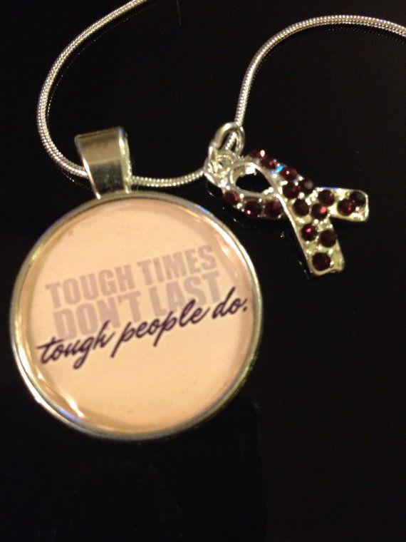 "Tough times don't last tough people do ""pendant with purple ribbon charm   Purple Ribbon: ADD, ADHD, Alzheimer's, Animal Abuse, Anit-Violence, Arnold Chiari Malformation (alt teal), Chronic Pain, Colitis (alt blue), Crohn's Disease (alt blue), Cystic Fibrosis, Domestic Violence (Alt Teal & Purple), Epilepsy (alt Lavender), Fibromyalgia (alt Cranberry), Fibromyalgia in Men, Harmony, Homelessness, Leimyosarcoma, Lupus (alt orange), Macular Degeneration, Mesh Survivor, Mucolididoses, Neuropathy…"