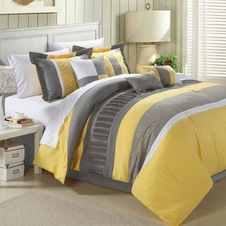 not a huge yellow lover, but this is pretty Embroidered Comforter set, featuring soft yellow and grey tones to ...