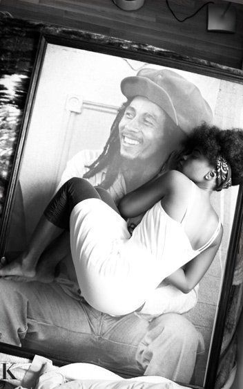Great pic of Bob Marley's daughter appearing to be held in her father's lap on photo