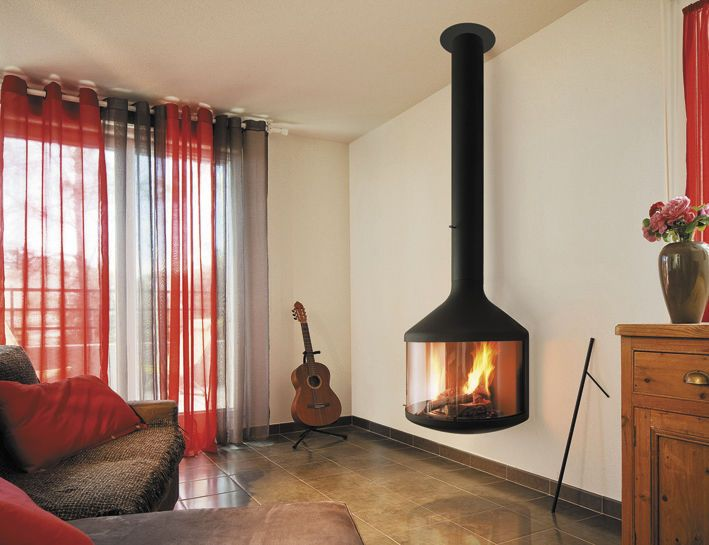 Wood fireplace / wall-mounted / contemporary / closed hearth HUBFOCUS Focus