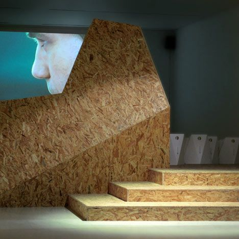 London designers Slowscape Collective created this temporary cinema at the Royal College of Art in London from faceted planes of oriented strand board.