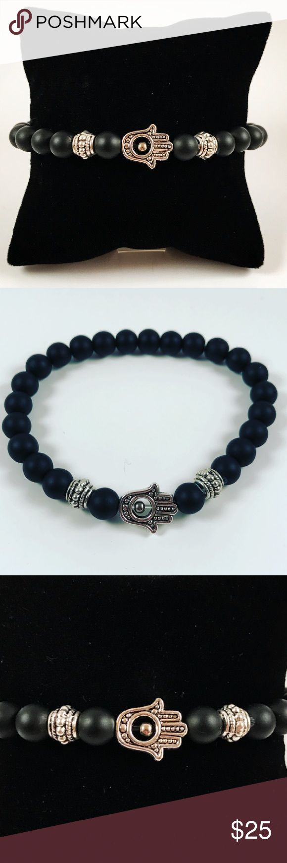 "SALE !! hamsa/hand of god & onyx beaded bracelet FREE GIFT WITH EVERY PURCHASE !! LET ME KNOW IF YOU WANT MEN OR WOMEN GIFT WHEN PURCHASING Men beaded bracelet. Fits most 7.5 to 8.5 inch wrist. Handmade by me , never worn by anyone. Made with black onyx and tibetan silver Hamsa / Hand of god / Fatima's hand charm. I ship fast!!✈️ Bundle and save! Any questions let me know! No transactions outside Poshmark!!  2 for $25!! All Items marked with the fox """" emoji are 2 for $25 just bundle and…"