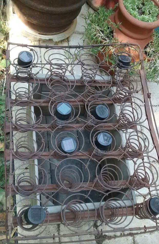 An Apple Box, Rusted Out Mattress Springs & Solar Lights = Cuteness!!!
