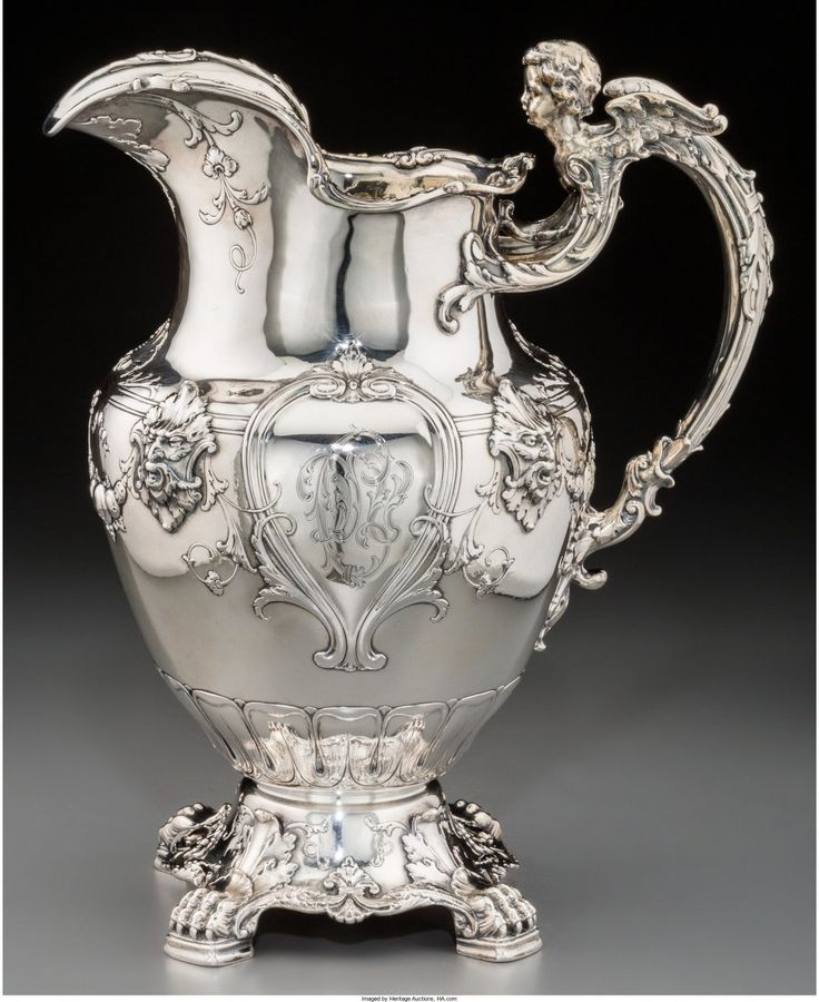 Lot: 74125: A Gorham Silver Figural Footed Pitcher, Providen, Lot Number: 74125, Starting Bid: $750, Auctioneer: Heritage Auctions, Auction: April 20 Fine Silver & Objects of Vertu #5297, Date: April 20th, 2017 EEST